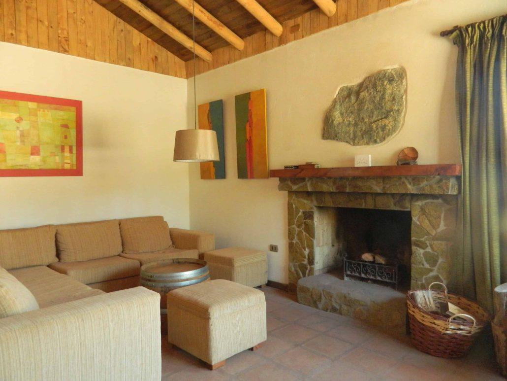 Living room, relax and fireplace - La Mirage Parador